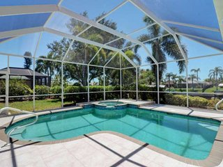 Two Luxurious Master Suites! Heated Pool & Spa Home on Gulf Access Canal! Free P