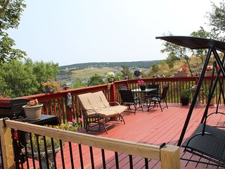 Back patio with variety of furnishings, summer months