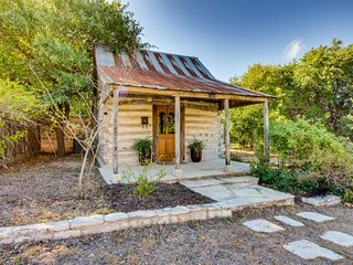 Historic tin roof log cabin with updated amenities - deep in the heart of Texas