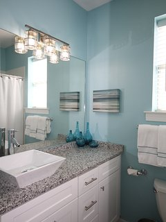 Master ensuite bath with vessel sink & tub/shower combo. Granite counters.
