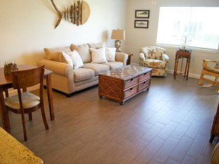 Escape to the Gulf in this 1b/1b Spacious Condo w/ a washer & dryer in the unit