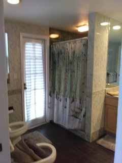 door from bath to pool and Shower