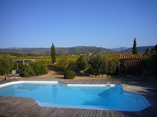 Vineyard setting with a fabulous views,private garden and large shared pool.