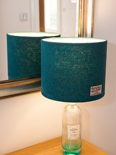 Our Isle of Harris Gin Bottle Lamp teamed up with some local Harris Tweed.