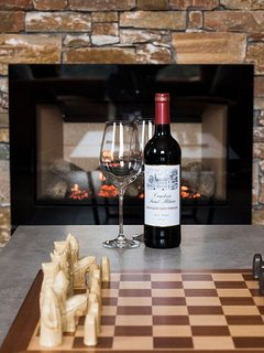 Relax in front of our real flame fire with a glass of wine & a game of Chess.