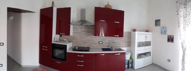 Large living room with kitchen equipped with dishwasher, table and Smart TV