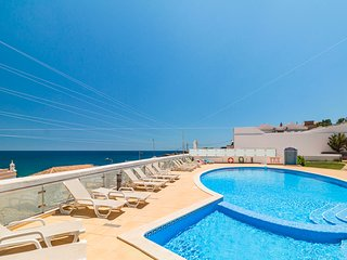 CHARMING CARVOEIRO 2 BEDROOM CLIFF SIDE APARTMENT WITH STUNNING VIEWS!