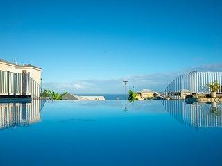 Ti'Sam, appartement avec piscine et vue panoramique sur l'océan