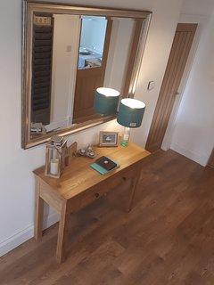The hallway dresser & our Harris Gin Bottle Lamp.