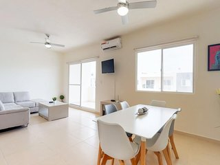 Family-friendly condo with shared pool, fitness room, & playground