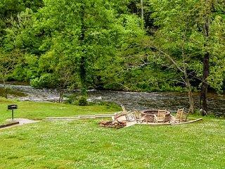 Riverfront condo w/ shared pool, firepit & decks - walk to hiking, biking trails