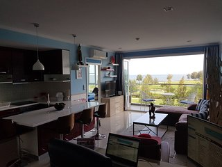 Superb top floor end unit with views over golf course and gulf of thailand