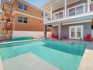 NEW LISTING! Brand new bayfront home with a private pool, dock, and water views!