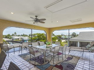 NEW LISTING! Spacious duplex-style condo w/enclosed patio & water views