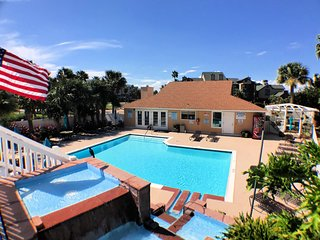 The Sandpiper Stay - Coastal Condo w/ Year Round Pool!
