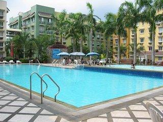 2 Br Condo Unit in a Tropical Resort