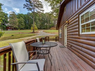 Dog-friendly cabin w/ forest view, a private hot tub, and a fire pit - near town
