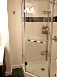 The modern and ultra-clean bathroom are just feet from your room.
