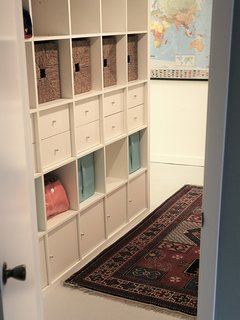 The hallway outside your room has extra shelves, a bench, and a world map to reflect on your trips!