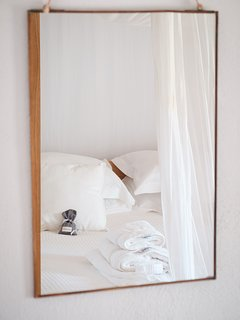 Pure white Egyptian cotton and thick, fluffy towels, shutters for a good nights' sleep and air-con.