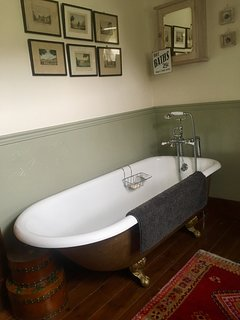 Roll top bath in upstairs bathroom.
