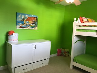 3rd bedroom features Queen murphy bed and set of twin bunks