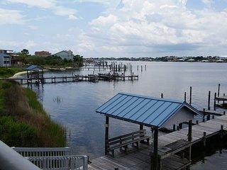Beautiful Waterfront Condo | Boat Slips | Private Boardwalk to Beach