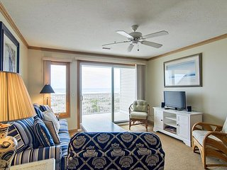 Coastal style condo nestled in the dunes at the north end