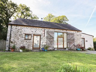 LLWYNBWCH BARN, detached barn conversion, two woodburners, nature reserve on-sit