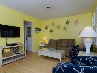Attractively decorated oceanside townhome with covered porches