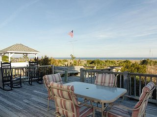 Enjoy ocean views from the wraparound porch at your classic beach cottage