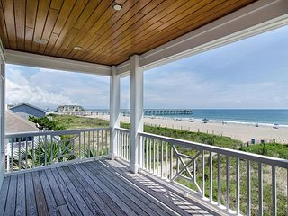 Enjoy paradise at this exquisite oceanfront home w/private beach access