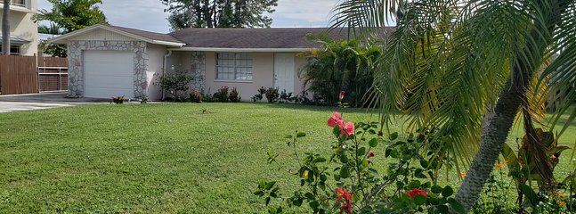 Cottage style 3 bedroom / 2 bathroom house on dead end street, quiet community on the water.
