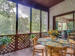 NEW LISTING! Upper-level riverfront condo w/screened porch, near downtown
