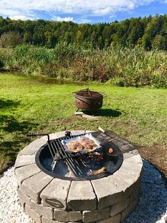 The newly installed firepit awaits your grilling expertise.