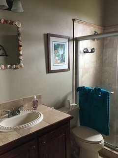 One of the upstairs bathrooms in one of the master suites