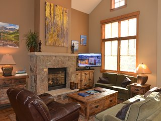 Come home to the warm bright living room to relax after a day outdoors!