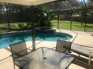 Gorgeous 4 bedroom Home close to Disney and Orlando with a private pool and Spa