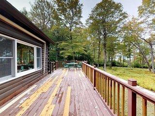 Beautiful rustic home w/ lake view, deck & firepit - walk to beach, 2 dogs OK!