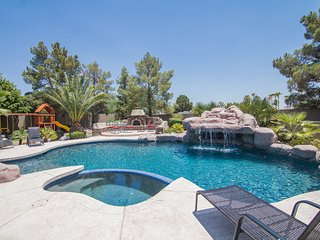 Mission Ranch = Resort style backyard & pool and a game room for everyone.