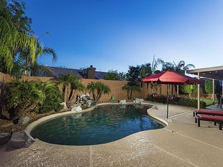 NEW LISTING w/ Backyard Oasis including Putting Green, Pool, Waterfall, &BBQ