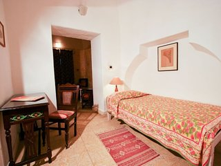 Well-appointed room with a shared pool, ideal for leisure travellers