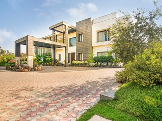 Luxurious 5-BR villa with a pool and a garden sit-out