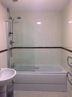 Modern Family bathroom with heated towel rail and towels included