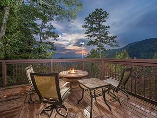 Sunset views from the porch with seating and fire table.