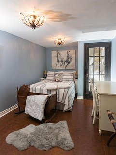 Bedroom with cotton sheets for a double bed. Two single roll-away beds are available