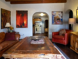 A cozy Santa Fe Style home. Private parking, fenced front and back yard with por
