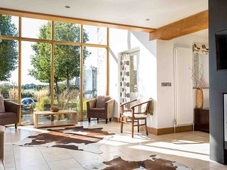 The floor to ceiling windows make it a bright living space, with lovely views