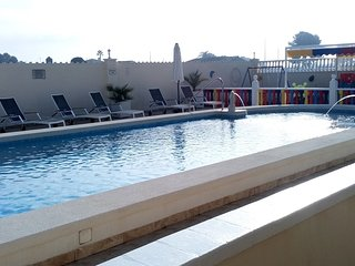 Swimming pool & children's play Area in Back ground.