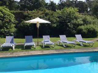 Secret walled garden cottage with private heated pool and secluded sandy beach.